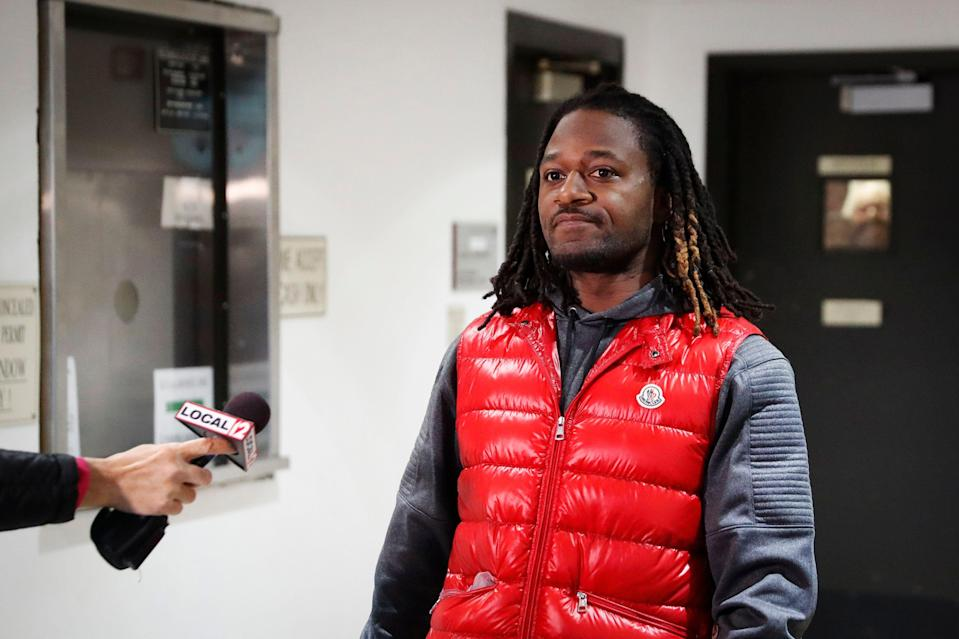 "Bengals cornerback Adam ""Pacman"" Jones prepares to speak with reporters as he is released from the Hamilton County Justice Center after be charged with felony harassment with a bodily substance, Wednesday, Jan. 4, 2017, in Cincinnati. He is also charged with assault, disorderly conduct and obstructing police. An attorney representing Jones has told a Hamilton County judge that he ""vehemently denies"" the charges that led to his arrest. (AP Photo/John Minchillo)"