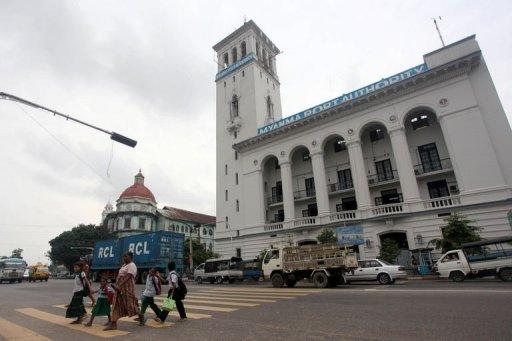 People are seen crossing a road in front of the 1905-built Myanmar Port Authority building in downtown Yangon. As a property boom triggers a flurry of construction activity in Yangon, the race is on to save the former colonial capital's architectural heritage from the wrecking ball