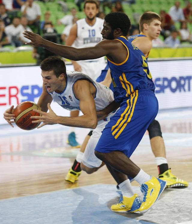 Ukraine's Eugene Jeter, right, tries to stop Italy's Andrea Cinciarini during their EuroBasket European Basketball Championship classification 5th to 8th place play off match in Ljubljana, Slovenia, Friday, Sept. 20, 2013. (AP Photo/Petr David Josek)
