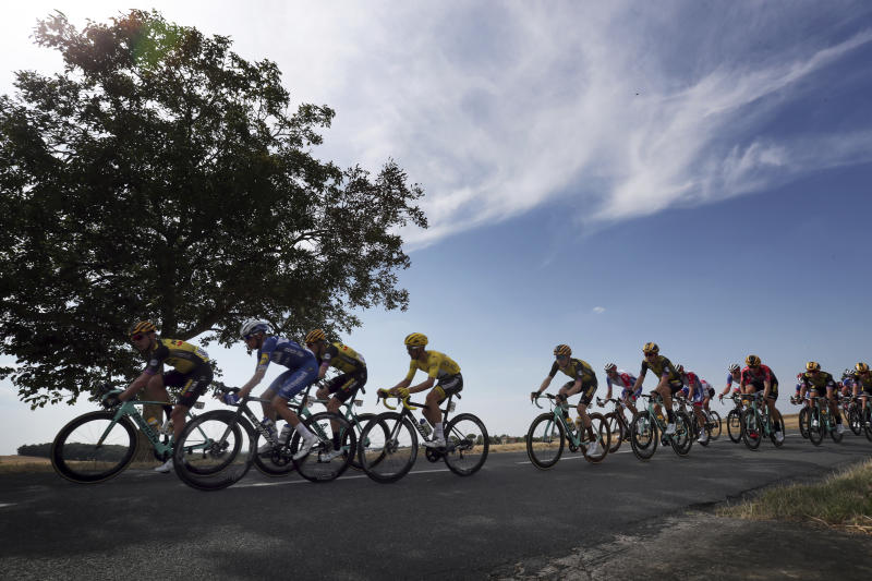 The pack rides during the eleventh stage of the Tour de France cycling race over 167 kilometers (103,77 miles) with start in Albi and finish in Toulouse, France, Wednesday, July 17, 2019. (AP Photo/Thibault Camus)