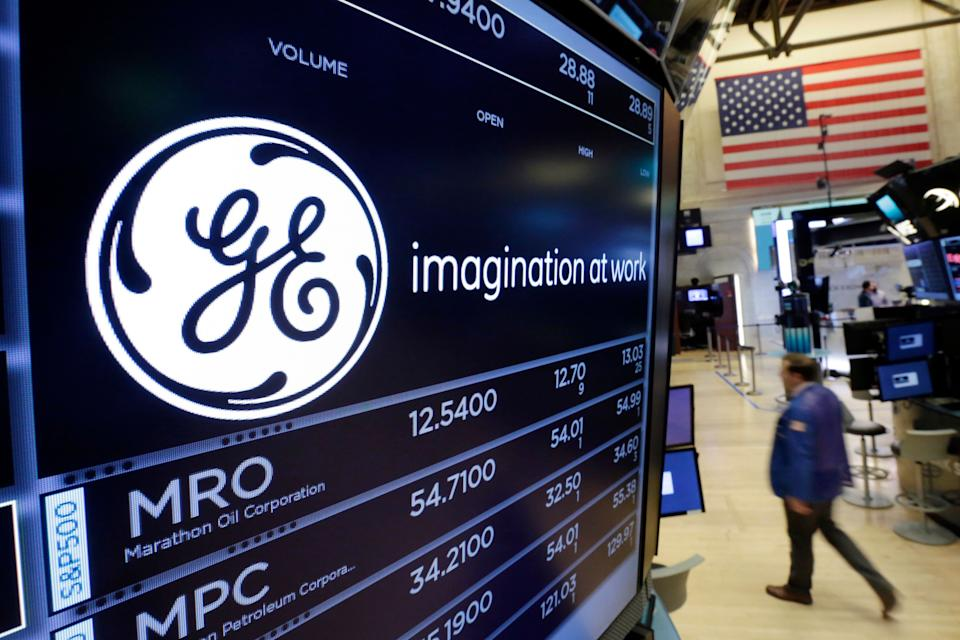 The General Electric logo appears above a trading post on the floor of the New York Stock Exchang. (AP Photo/Richard Drew)