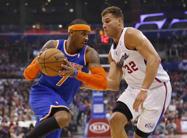 New York Knicks' Carmelo Anthony, left, drives with the ball as Los Angeles Clippers' Blake Griffin, right, defends, during the first half of an NBA basketball game in Los Angeles, Wednesday, Nov. 27, 2013. (AP Photo/Danny Moloshok)