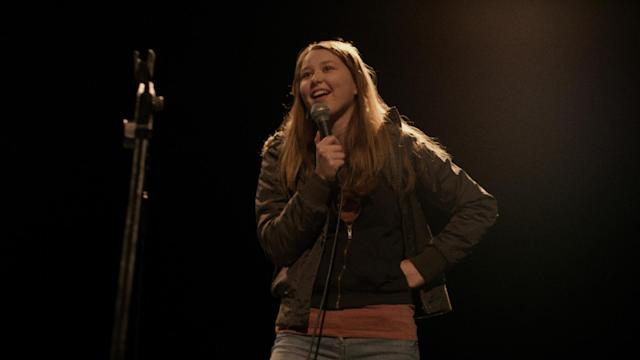 Liv Hill turns her hand to stand-up comedy in gritty British drama 'Jellyfish'. (Credit: Republic Film Distribution)
