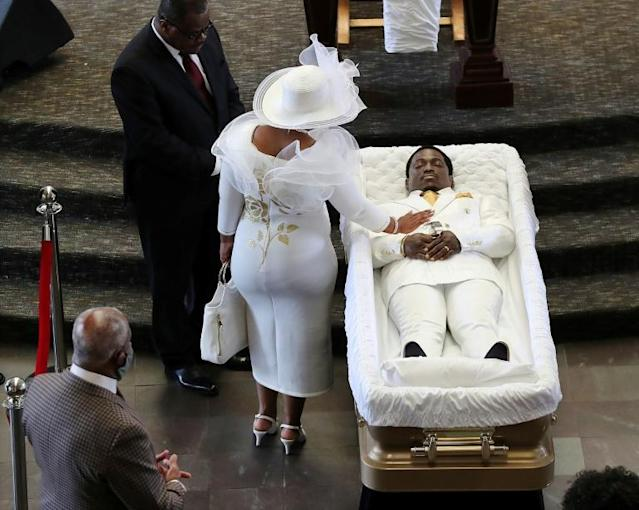 Tomika Miller, the wife of Rayshard Brooks, touches her husband Rayshard Brook's body in a funeral ceremony at Atlanta's Ebenezer Baptist Church on June 22 (AFP Photo/Curtis Compton)