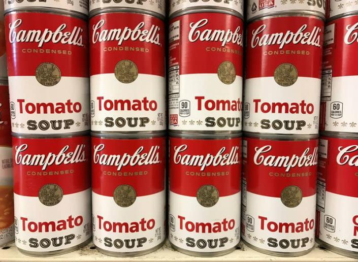 FILE PHOTO: Tins of Campbell's Tomato Soup are seen on a supermarket shelf in Seattle