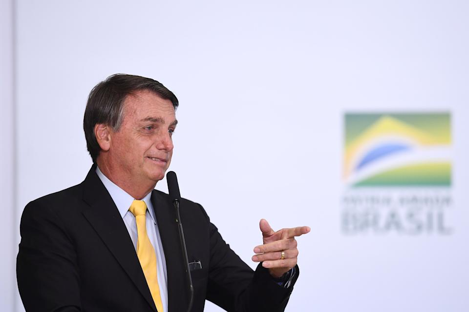 Brazilian President Jair Bolsonaro gestures during an event to announce the clinical study of the use of Nitazoxanide in an early treatment against COVID-19, at Planalto Palace in Brasilia, on October 19, 2020. (Photo by EVARISTO SA / AFP) (Photo by EVARISTO SA/AFP via Getty Images)