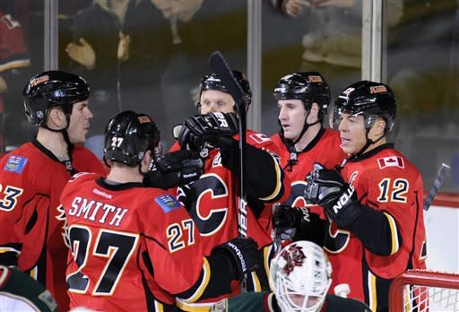 Calgary Flames' Jarome Iginla, right, celebrates his goal against the Minnesota Wild with, Scott Hannan (left to right), Derek Smith, Olli Jokinen, from Finland and Curtis Glencross during second period NHL action in Calgary, Alberta, Tuesday Dec. 20, 2011. (AP Photo/The Canadian Press, Larry MacDougal)