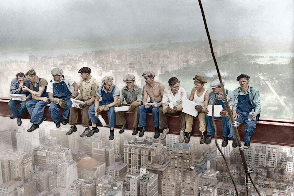 <p>Construction workers eat their lunch atop a steel beam, 800 feet above the ground, at the building site of the RCA Building in Rockefeller Center.</p>