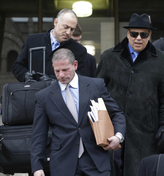 Defense Lawyers for Drew Peterson, back left, Steve Greenberg, Joe Lopez, right, and David J. Peilet, front, leave the Will County Courthouse Tuesday, Feb. 19, 2013, in Joliet, Ill., after a hearing in Drew Peterson's murder trial. The hearing for Peterson ended without a ruling on the former suburban Chicago police officer's request for a new trial. A judge recessed Tuesday after the defense sought to bolster arguments Peterson deserved a retrial on charges he murdered his third wife, Kathleen Savio. Peterson's attorneys contend his former lead trial attorney, Joel Brodsky, botched his case. (AP Photo/M. Spencer Green)