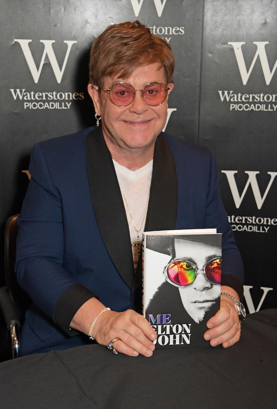"Sir Elton John signs copies of his autobiography ""Me"" for fans at Waterstones Piccadilly on November 20, 2019 in London, England.  (Photo by David M. Benett/Dave Benett/Getty Images for Macmillan)"