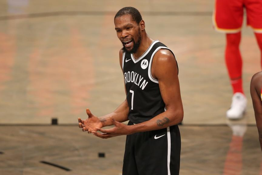 Kevin Durant reacts after call by official against Hawks