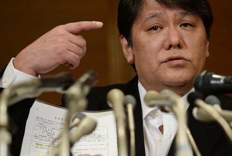 Mamoru Samuragochi, dubbed 'Japan's Beethoven', shows his medical certificate during a press conference in Tokyo, in March 2014