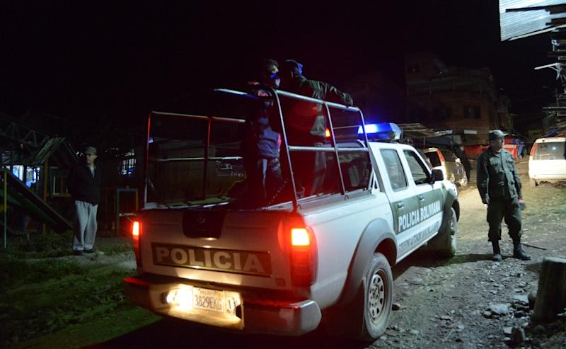 Police patrol the streets of the village of La Asunta, Yungas, Bolivia on June 19, 2015, where local authorities have decreed a curfew for those under 18 years old and a ban in the sale of alcoholic beverages