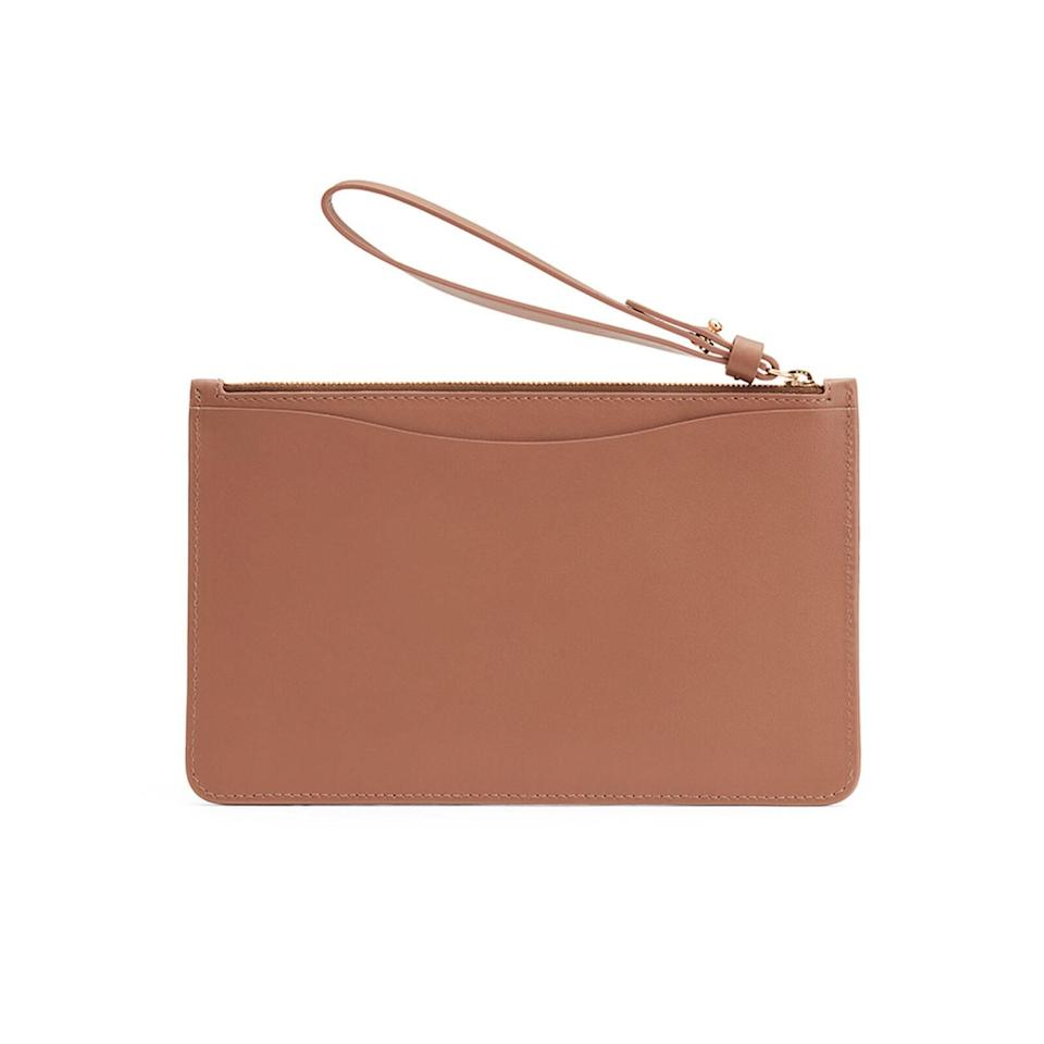 """A classic source of high-quality leather goods, Cuyana is all about minimalism. We especially love the warm caramel color of this straightforward wristlet wallet. $115, Cuyana. <a href=""""https://www.cuyana.com/small-leather-goods/wallets/slim-wristlet-wallet/10051038.html?dwvar_10051038_color=caramel"""" rel=""""nofollow noopener"""" target=""""_blank"""" data-ylk=""""slk:Get it now!"""" class=""""link rapid-noclick-resp"""">Get it now!</a>"""