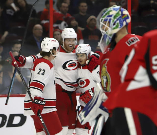 Carolina Hurricanes' Dougie Hamilton (19) celebrates his goal against the Ottawa Senators with teammates Brock McGinn (23) and Sebastian Aho (20) during second-period NHL hockey play in Ottawa, Ontario, Sunday, Jan. 6, 2019. (Fred Chartrand/The Canadian Press via AP)