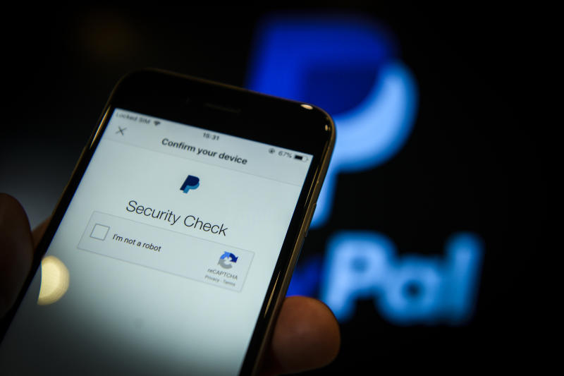 PayPal security check displayed on phone screen.