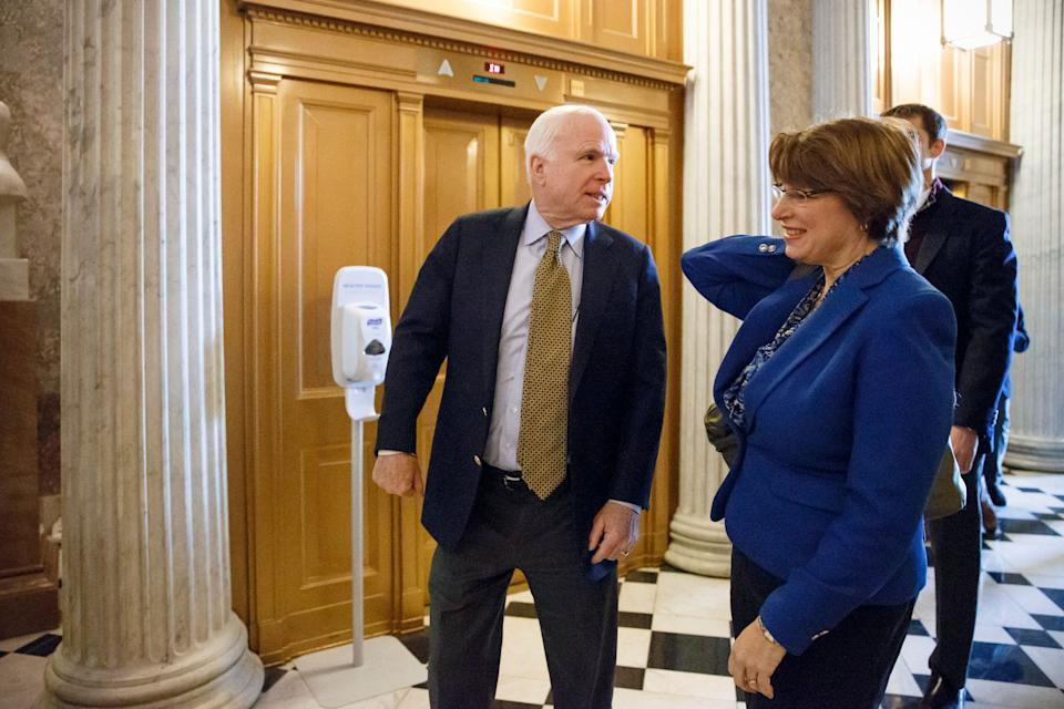 Senate Armed Services Committee Chairman Sen. John McCain, R-Ariz., left, and Sen. Amy Klobuchar, D-Minn., head to the Senate floor on Capitol Hill in Washington, Friday, Feb. 27, 2015, as Congress closed in on approving a short-term spending bill for the Homeland Security Department that would avert a partial agency shutdown hours before it was to begin. The legislation also leaves intact Obama administration executive actions on immigration that Republicans have vowed to overturn.  (AP Photo/J. Scott Applewhite)