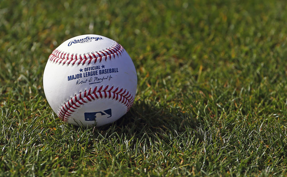 FILE - In this Feb. 17, 2017, file photo, a baseball is shown on the grass at the Cincinnati Reds baseball spring training facility in Goodyear, Ariz. Major League Baseball rejected the players' offer for a 114-game regular season in the pandemic-delayed season with no additional salary cuts and told the union it did not plan to make a counterproposal, a person familiar with the negotiations told The Associated Press. The person spoke on condition of anonymity Wednesday, June 3, 2020, because no statements were authorized. (AP Photo/Ross D. Franklin, FIle)