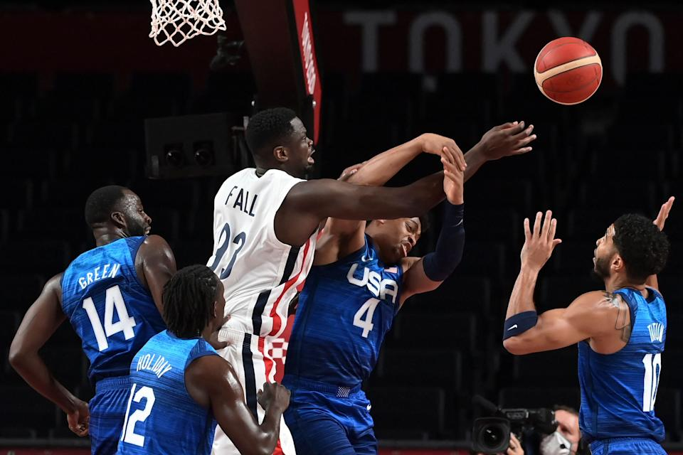 France's Moustapha Fall (3L) fights for the ball with USA's Keldon Johnson (2R) during the men's preliminary round group A basketball match between France and USA during the Tokyo 2020 Olympic Games at the Saitama Super Arena in Saitama on July 25, 2021. (Photo by Aris MESSINIS / AFP) (Photo by ARIS MESSINIS/AFP via Getty Images)