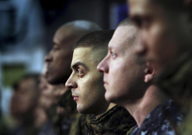 """Sailors and Marines listen as Navy Secretary Ray Mabus addresses them aboard the LHD Bataan at Norfolk Naval Station in Norfolk, Va., on Monday, March 5, 2012, during an """"all hands"""" call that was televised and streamed live worldwide. Mabus outlined new initiatives in five areas, including responsible use of alcohol and reducing sexual assaults and suicides. (AP Photo/Virginian-Pilot, Vicki Cronis-Nohe) MAGS OUT"""