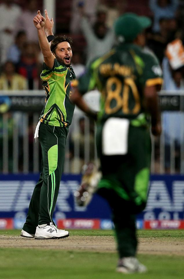 SHARJAH, UNITED ARAB EMIRATES - DECEMBER 18: Shahid Afridi of Pakistan celebrate after dismissing Lahiru Thirimanna of Sri Lanka during the first One-Day International (ODI ) match between Sri Lanka and Pakistan at the Sharjah Cricket Stadium on December 18, 2013 in Sharjah, United Arab Emirates.  (Photo by Francois Nel/Getty Images)