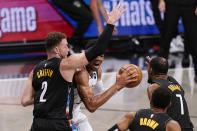 Brooklyn Nets forwards Blake Griffin (2) and Kevin Durant (7) defend against Milwaukee Bucks forward Giannis Antetokounmpo during the first half of Game 2 of an NBA basketball second-round playoff series, Monday, June 7, 2021, in New York. (AP Photo/Kathy Willens)