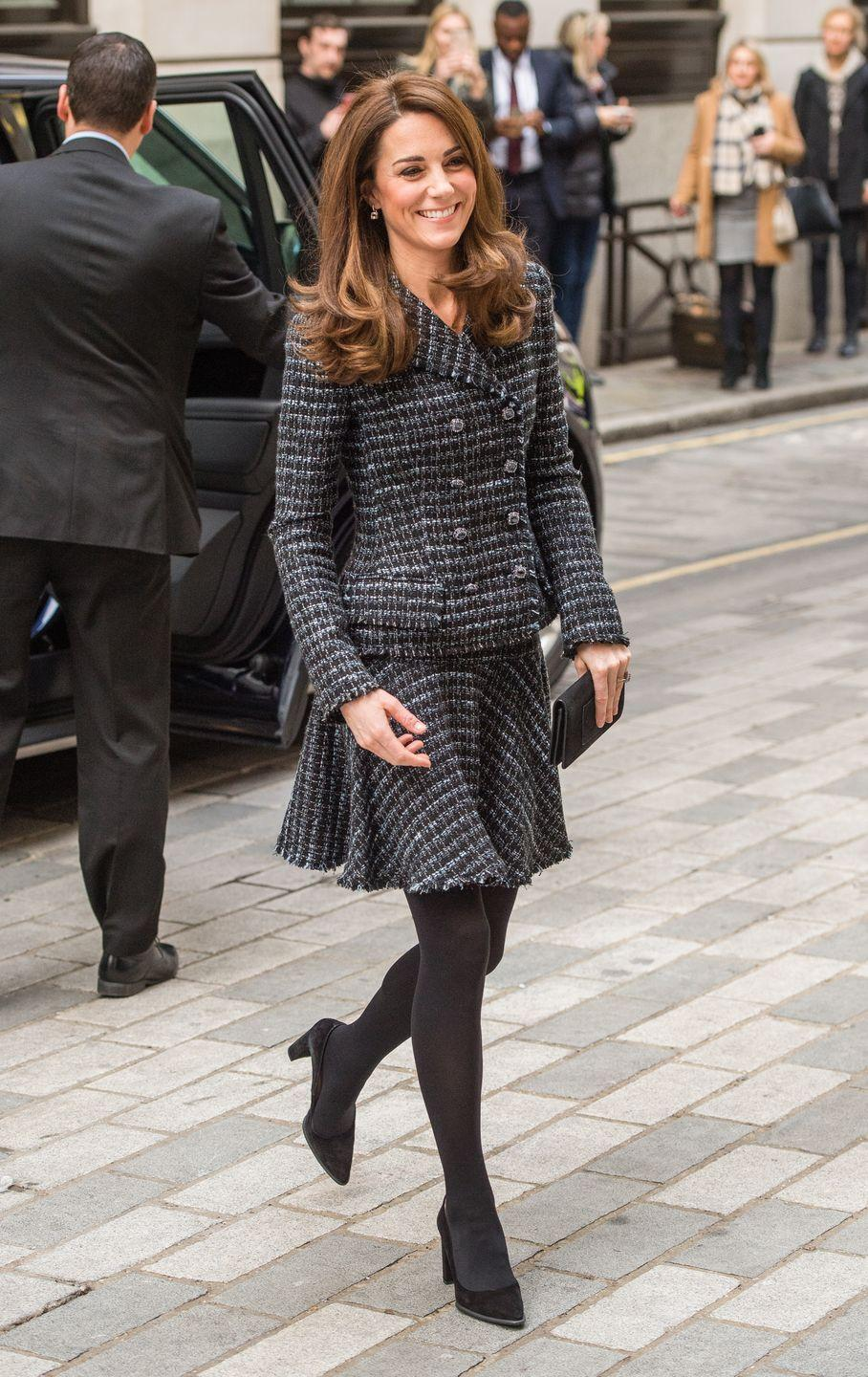 <p>Duchess Kate arrived at the Royal Foundation's 'Mental Health in Education' Conference wearing a dark tweed skirt suit paired with black tights and pumps. She was also carrying a small black clutch. </p>