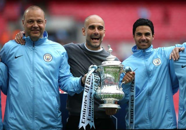 Arteta (right) and Guardiola (centre) worked together for almost three years at Manchester City.