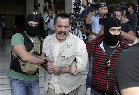 Lawmaker of extreme-right Golden Dawn party Christos Pappas shouts as he leaves the Greek police headquarters in Athens