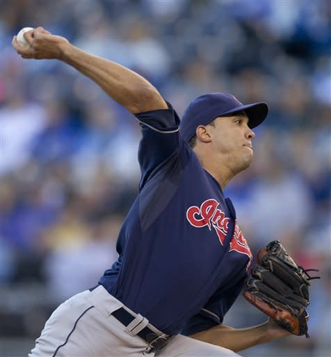 Cleveland Indians starting pitcher Ubaldo Jimenez works against a Kansas City Royals batter during the first inning of a baseball game at Kauffman Stadium in Kansas City, Mo., Saturday, Sept. 22, 2012. (AP Photo/Orlin Wagner)