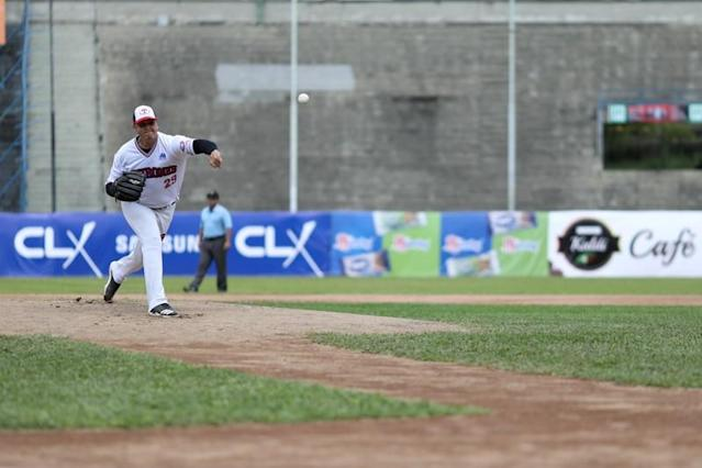 Pitcher from Tiburones de La Guaira team, practices before a game at University Stadium in Caracas