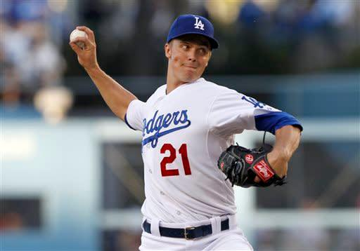 Los Angeles Dodgers starting pitcher Zack Greinke works against the Philadelphia Phillies in the first inning of a baseball game Thursday, June 27, 2013, in Los Angeles. (AP Photo/Alex Gallardo)