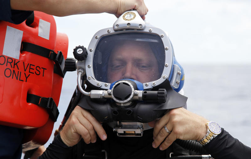 D.J. Roller adjusts his helmet before a dive to the undersea research laboratory Aquarius Reef Base, Friday, July 13, 2012, in the Florida Keys. Also pictured from left to right are Dale Stokes, D.J. Roller, and Mark Patterson. NOAA owns the lab that has rested for decades some 60 feet below the water's surface on the Conch Reef in the Florida Keys National Marine Sanctuary. But federal budget cuts threaten to close the undersea lab unless it can secure private funding. (AP Photo/Lynne Sladky)