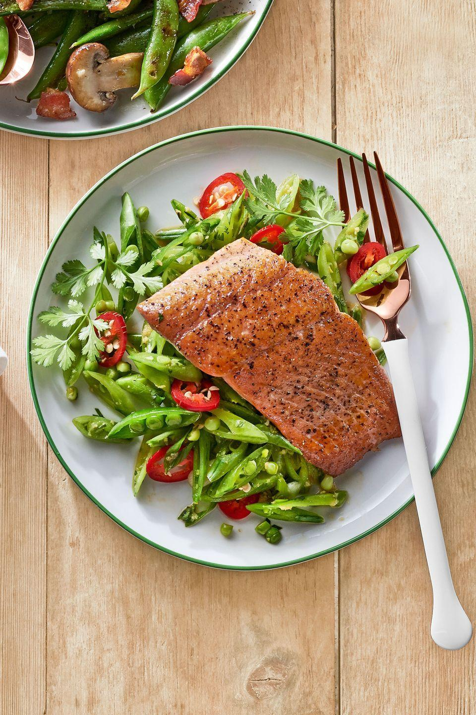"""<p>Bring a little snap (peas) to the table with this quick and easy dinner.</p><p><strong><a href=""""https://www.countryliving.com/food-drinks/recipes/a37755/gingery-snap-pea-slaw-with-seared-salmon-recipe/"""" rel=""""nofollow noopener"""" target=""""_blank"""" data-ylk=""""slk:Get the recipe"""" class=""""link rapid-noclick-resp"""">Get the recipe</a>.</strong></p>"""