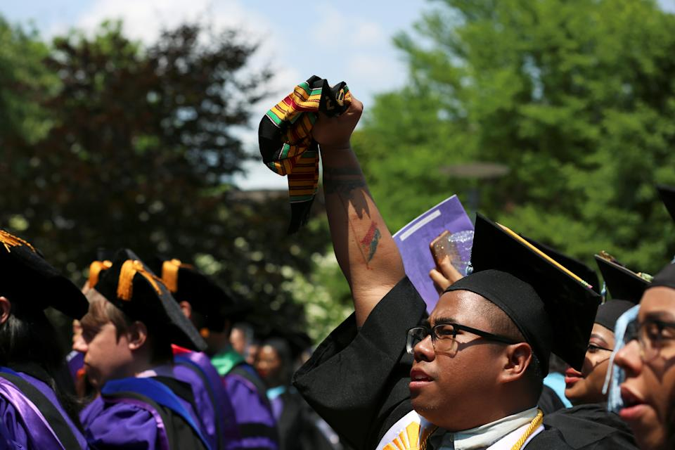 A graduate throws his fist in the air after congressman John Robert Lewis, 2019 honorarium of The City College of New York, speaks at the commencement ceremony in Manhattan on May 31, 2019. REUTERS/Gabriela Bhaskar