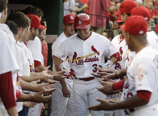 St. Louis Cardinals' Carlos Beltran (3) celebrates with teammates after hitting a solo home run in the third inning of a baseball game against the Chicago White Sox, Wednesday, June 13, 2012, in St. Louis.(AP Photo/Tom Gannam)