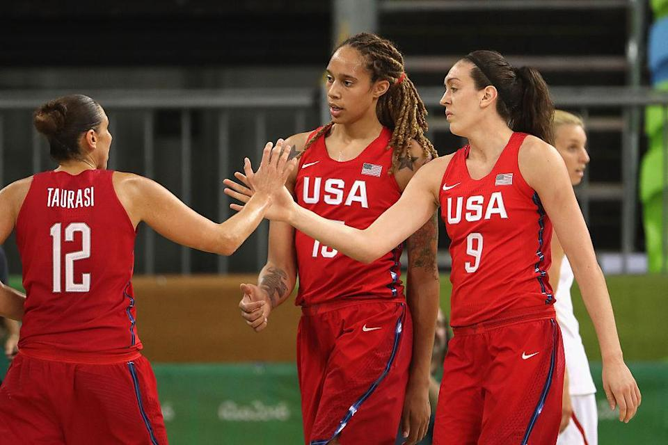 Breanna Stewart (right) and Brittney Griner (center) high-five Diana Taurasi after scoring during Team USA's win over Spain. (Christian Petersen/Getty Images)