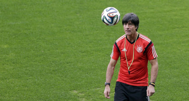 German national soccer team coach Joachim Loew watches a ball during an official training session one day before the World Cup semifinal soccer match between Brazil and Germany at the Mineirao Stadium in Belo Horizonte, Brazil, Monday, July 7, 2014. (AP Photo/Matthias Schrader)
