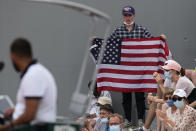 A United States fan holds up the American flag as he watches United States' John Isner play against Serbia's Filip Krajinovic on day four of the French Open tennis tournament at Roland Garros in Paris, France, Wednesday, June 2, 2021. (AP Photo/Michel Euler)