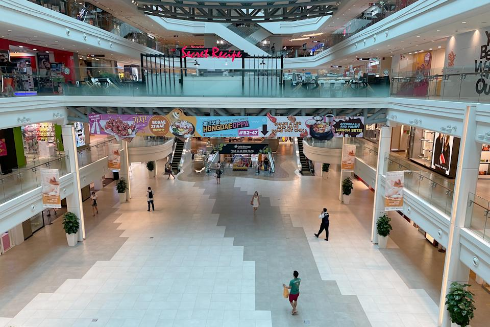 People seen at the Plaza Singapura shopping mall on 24 May 2021 amid Singapore's Phase 2 (Heightened Alert) period. (PHOTO: Dhany Osman / Yahoo News Singapore)