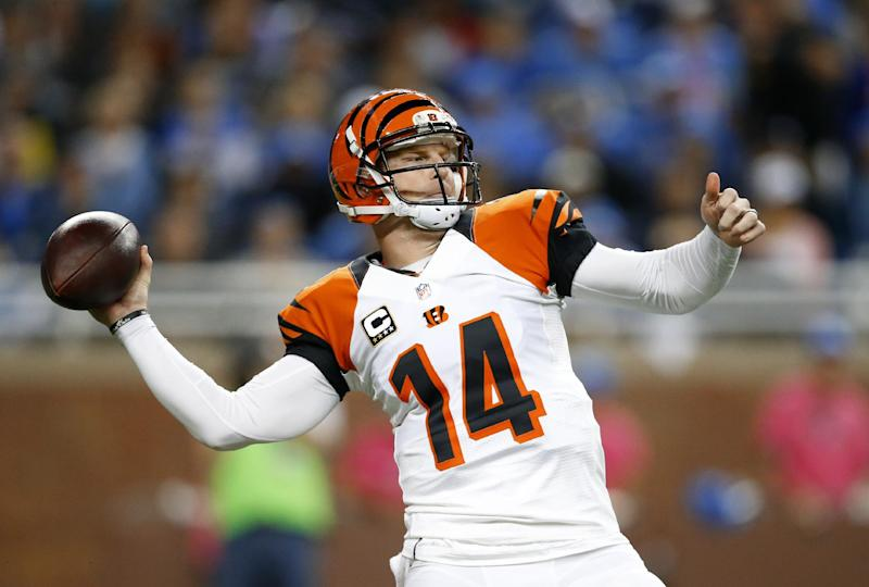 Cincinnati Bengals quarterback Andy Dalton throws against the Detroit Lions in the first quarter of an NFL football game Sunday, Oct. 20, 2013, in Detroit. (AP Photo/Rick Osentoski)