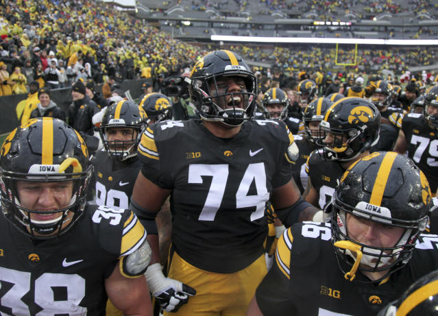 Iowa offensive lineman Tristan Wirfs celebrates with teammates after a 2018 game at Kinnick Stadium, in Iowa City, Iowa. (Photo by Matthew Holst/Getty Images)
