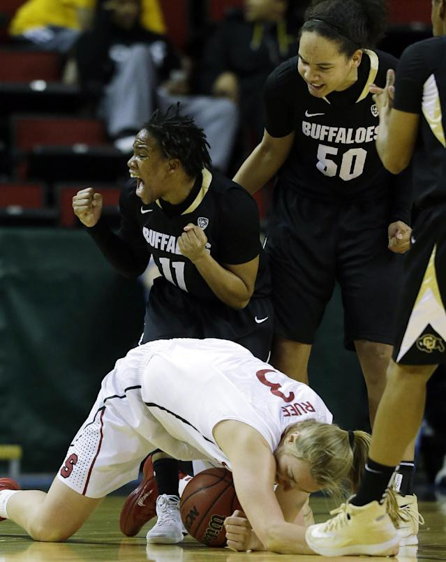 Colorado's Brittany Wilson (11) and Jamee Swan (50) celebrate after Stanford's Mikaela Ruef (3) went down on a play in the first half of an NCAA college basketball game in the second round of the Pac-12 women's tournament, Friday, March 7, 2014, in Seattle. (AP Photo/Ted S. Warren)