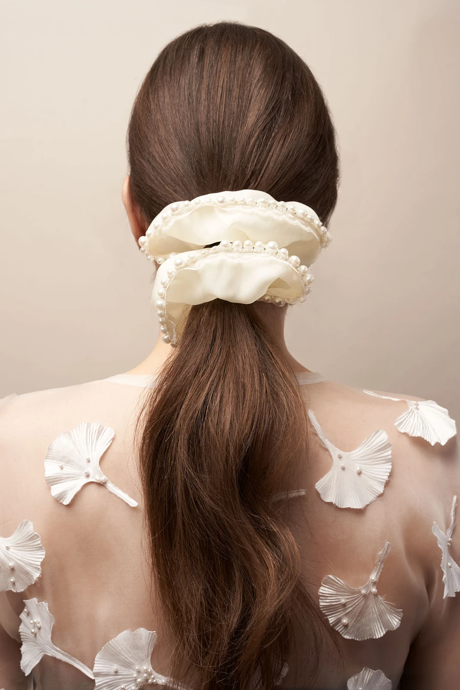 """<h3>MLE Ever After Scrunchie</h3><br>Have you seen a more holiday-appropriate hair accessory? MLE makes most of their pieces made to order in NYC. Their giftable goods range from this beautiful silk number to <a href=""""https://madebymle.com/collections/hair-clips/products/cloud-clip-cream"""" rel=""""nofollow noopener"""" target=""""_blank"""" data-ylk=""""slk:cloud claw clips"""" class=""""link rapid-noclick-resp"""">cloud claw clips</a>, <a href=""""https://madebymle.com/collections/gift-sets"""" rel=""""nofollow noopener"""" target=""""_blank"""" data-ylk=""""slk:gift sets"""" class=""""link rapid-noclick-resp"""">gift sets</a>, and even a thing or two for the <a href=""""https://madebymle.com/collections/dog-accessories"""" rel=""""nofollow noopener"""" target=""""_blank"""" data-ylk=""""slk:pup"""" class=""""link rapid-noclick-resp"""">pup</a> in your life. <br><br><strong>MLE</strong> Ever After Scrunchie, $, available at <a href=""""https://go.skimresources.com/?id=30283X879131&url=https%3A%2F%2Fmadebymle.com%2Fcollections%2Fhair-accessories%2Fproducts%2Fever-after-scrunchie"""" rel=""""nofollow noopener"""" target=""""_blank"""" data-ylk=""""slk:MLE"""" class=""""link rapid-noclick-resp"""">MLE</a>"""