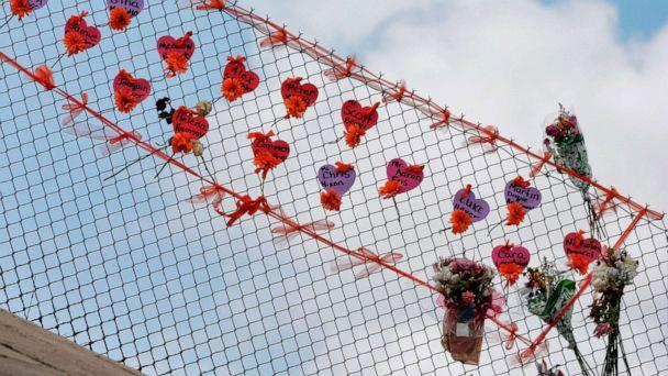 PHOTO: Memorials are seen on a fence surrounding Marjory Stoneman Douglas High School in Parkland, Florida on Feb. 21, 2018. (Rhona Wise/AFP/Getty Images, FILE)