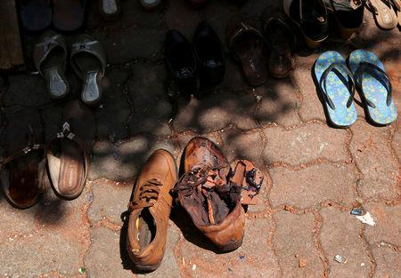 Blood is seen on a pair of shoes at St. Sebastian Catholic Church in Negombo
