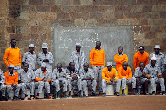 <p>Kenyan prisoners watch a mock World Cup soccer match between Russia and Saudi Arabia as part of a monthlong soccer tournament at the Kamiti Maximum Security Prison, Kenya's largest prison facility, near Nairobi, on June 14, 2018. (Photo: Baz Ratner/Reuters) </p>