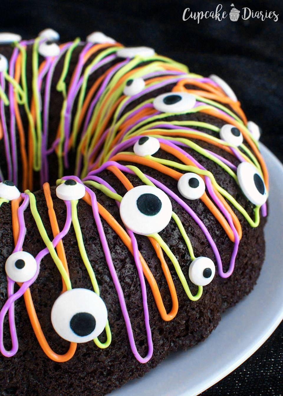"""<p>Kids will love decorating this chocolate cake with colorful icing and candy """"eyes.""""</p><p><strong>Get the recipe at <a href=""""https://www.cupcakediariesblog.com/2016/09/monster-bundt-cake.html?utm_content=buffer35bc7&utm_medium=social&utm_source=pinterest.com&utm_campaign=buffer"""" rel=""""nofollow noopener"""" target=""""_blank"""" data-ylk=""""slk:Cupcake Diaries"""" class=""""link rapid-noclick-resp"""">Cupcake Diaries</a>.</strong> </p>"""