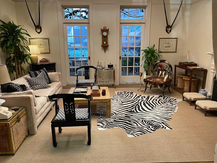 """""""The horn chair in the penthouse living room was difficult to find and costs a fortune. It would probably run $6,000 by now. One-of-a-kind pieces are quite a challenge, so we used a cowhide rug instead of a zebra,"""" says Hale."""