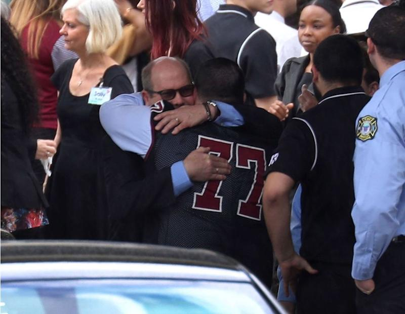 Mourners at Aaron Feis' funeral